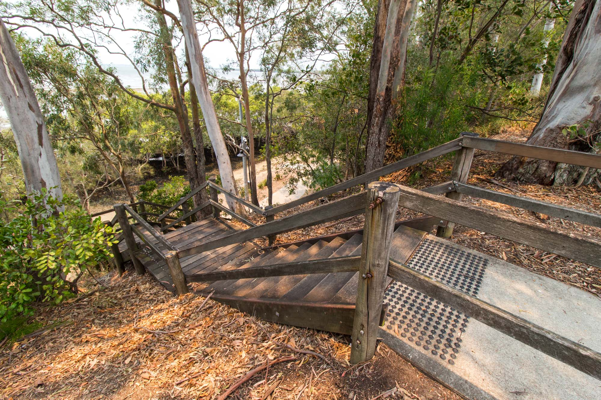 Set of wooden stairs leading to the top footpath along Captain Cook Parade